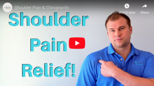 Chiropractor discussing shoulder pain relief