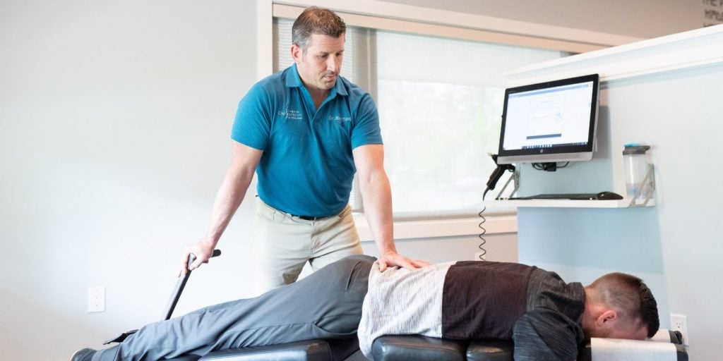 Chiropractor treating patient with lower back issues